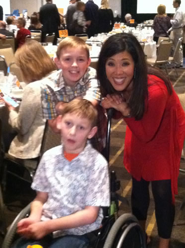 ABC7 Morning News anchor Kristen Sze with Conner and Cayden Long at Gatepath's Power of Possibilities event.