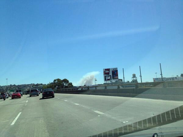 A four-alarm fire burning on San Bruno Mountain in South San Francisco sent a large plume of smoke in the air that was visible from several miles away. (Photo submitted via Twitter from @NickThulin)
