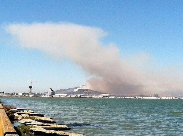 A four-alarm fire burning on San Bruno Mountain in South San Francisco sent a large plume of smoke in the air that was visible from several miles away. (Photo submitted via Twitter from @Joyce_Lin)