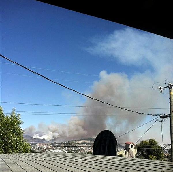 "<div class=""meta ""><span class=""caption-text "">A four-alarm fire burning on San Bruno Mountain in South San Francisco sent a large plume of smoke in the air that was visible from several miles away. (Photo submitted via uReport by anonymous user) </span></div>"
