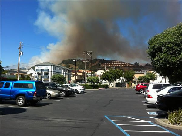 "<div class=""meta image-caption""><div class=""origin-logo origin-image ""><span></span></div><span class=""caption-text"">A four-alarm fire burning on San Bruno Mountain in South San Francisco sent a large plume of smoke in the air that was visible from several miles away. (Photo submitted via uReport by anonymous user)</span></div>"