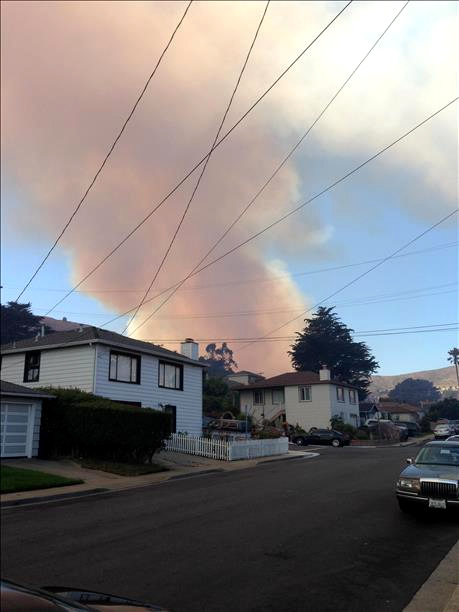 A four-alarm fire burning on San Bruno Mountain in South San Francisco sent a large plume of smoke in the air that was visible from several miles away. (Photo submitted via uReport by boxcarmicki)
