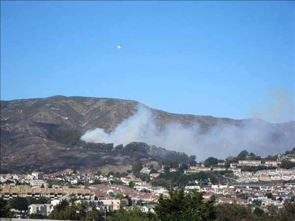 "<div class=""meta ""><span class=""caption-text "">A four-alarm fire burning on San Bruno Mountain in South San Francisco sent a large plume of smoke in the air that was visible from several miles away. (Photo submitted via uReport by anonymous user)</span></div>"