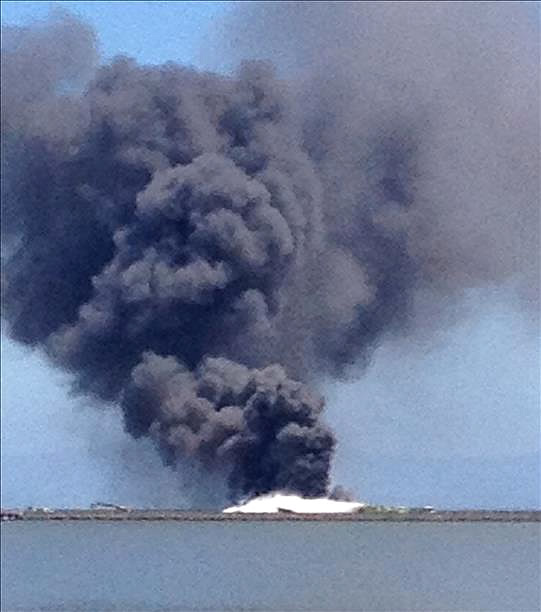 Heavy smoke coming from the Boeing 777 that crash landed at the San Francisco International Airport on Saturday. <span class=meta>(Photo submitted via uReport)</span>