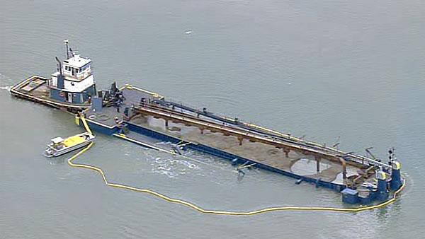 Barge beached near St. Francis Yacht Club