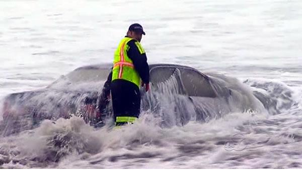 Woman drives car into water at Ocean Beach