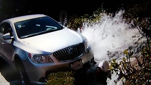 Car strikes hydrant on crooked part of Lombard St.
