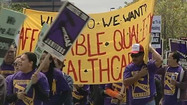 Silicon Valley janitors rally over contract dispute