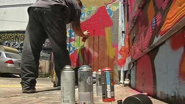 Mission District fights graffiti by covering walls with art