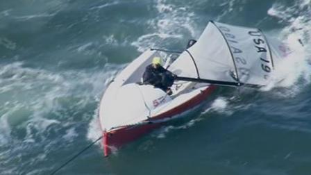 Three people were rescued by the U.S. Coast Guard after the mast broke on their sailboat in San Francisco Bay.
