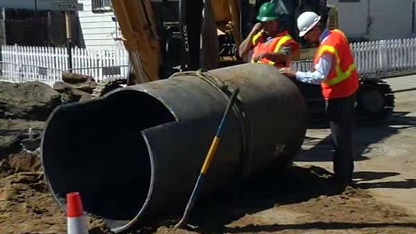 Residents return home after huge water main break