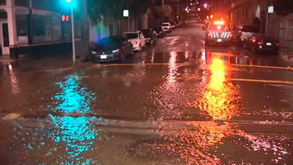 Water main break floods SF intersectionWater main break floods SF intersection