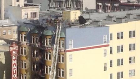 SF Tenderloin apartment buildings roof on fire