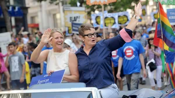 Proposition 8 plaintiffs Kris Perry, left, and Sandy Stier ride in San Francisco's 43rd annual gay pride parade
