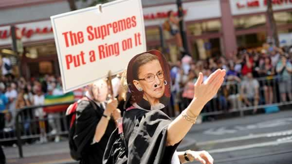 Wearing a mask of U.S. Supreme Court Justice Ruth Bader Ginsburg, a reveler marches in San Francisco's 43rd annual gay pride parade