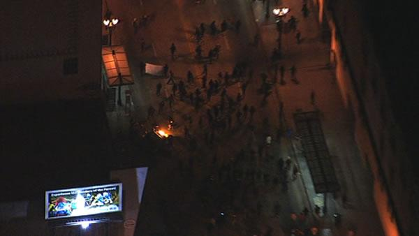 Crowd sets street on fire during march through Oakland to protest the George Zimmerman verdict.