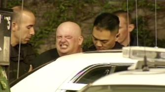 A man suspected of shooting a San Francisco police officer being taken into custody.