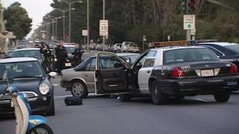 A San Francisco officer has been hospitalized following a pursuit that ended in a crash in the Richmond District on Saturday.