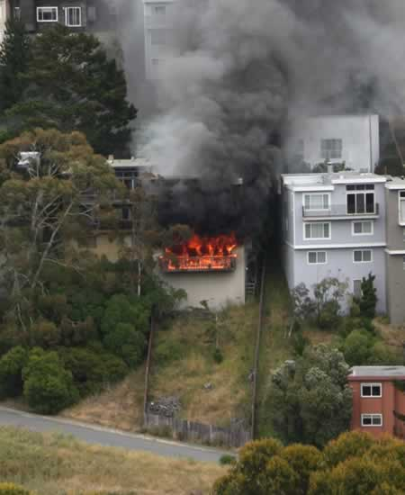 San Francisco firefighters battled a blaze in the Diamond Hills neighborhood Thursday afternoon. The fire claimed the lfie of one firefighter and injured two others.  (Photo submitted by Mark via uReport)