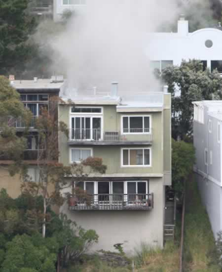 "<div class=""meta ""><span class=""caption-text "">San Francisco firefighters battled a blaze in the Diamond Hills neighborhood Thursday afternoon. The fire claimed the lfie of one firefighter and injured two others.  (Photo submitted by Mark via uReport) </span></div>"