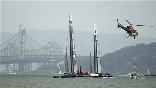 Artemis Team White of Sweden, left, races against Team Korea, right, with the San Francisco-Oakland Bay Bridge in the background during their quarterfinal match race of the America&#39;s Cup World Series sailing event in San Francisco, Thursday, Oct. 4, 2012. Racing of the AC45 boats continues though Sunday on San Francisco Bay. Artemis Team White won their race. <span class=meta>(AP Photo&#47;Eric Risberg)</span>