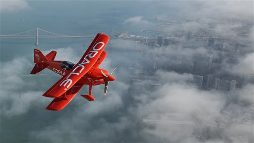 In preparation for Fleet Week performances, Team Oracle stunt pilot Sean D. Tucker flies over San Francisco on Thursday, Oct. 4, 2012. <span class=meta>(AP Photo&#47;Noah Berger)</span>
