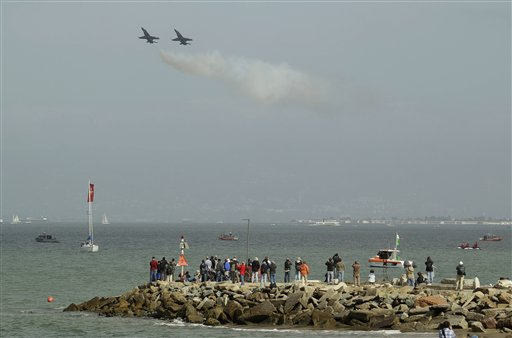 People watch from the waterfront as pair of Navy Blue Angels F&#47;A-18&#39;s come to a near stall above San Francisco Bay off the Marina Green in San Francisco, Thursday, Oct. 4, 2012. The Blue Angels were practicing for the annual Fleet Week celebration this weekend.  <span class=meta>(AP Photo&#47;Eric Risberg)</span>