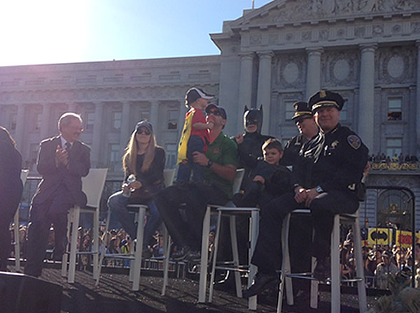 Batkid sits next to his family, Mayor Ed Lee and San Francisco police in front of City Hall on November 15, 2013. <span class=meta>(KGO)</span>