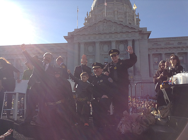 Batkid, Mayor Ed Lee and San Francisco police pose for a photo in front of City Hall on November 15, 2013. <span class=meta>(KGO)</span>