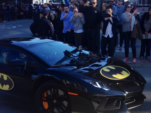Batkid smiles inside the Batmobile in front of San Francisco's AT&T Park on November 15, 2013.