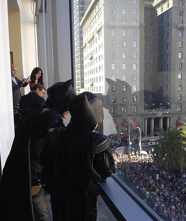 Batkid looks down at a large crown in San Francisco's Union Square on November 15, 2013.