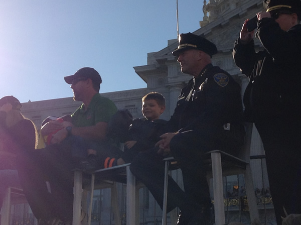 Batkid sits next to his family and San Francisco police in front of City Hall on November 15, 2013. <span class=meta>(KGO)</span>