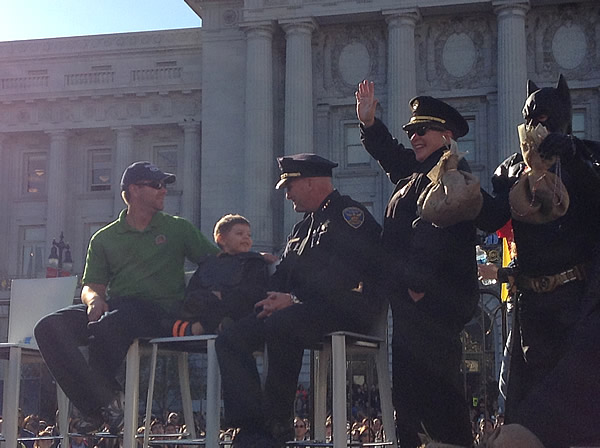 San Francisco police stand next to Batkid in front of City Hall on November 15, 2013. <span class=meta>(KGO)</span>