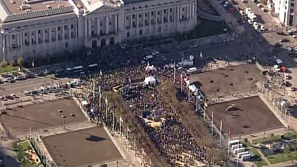 A large crowd waits for the arrival of Batkid at City Hall in San Francisco before he is awarded the key to the city on November 15, 2013.