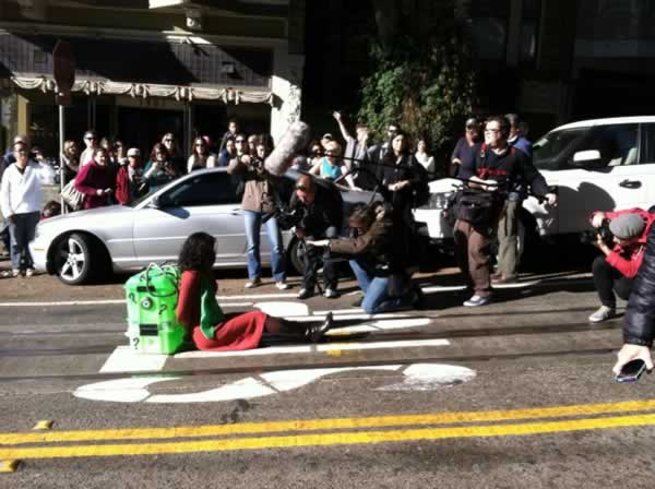 "<div class=""meta ""><span class=""caption-text "">A damsel in distress at Hyde and Green hoping for Batkid to come and save the day in ""Gotham City,"" in San Francisco on November 15, 2013. (ABC7 News)</span></div>"