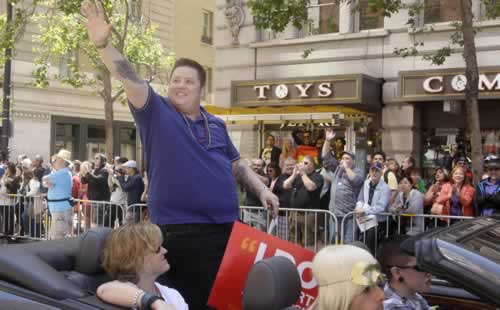 Chaz Bono, a celebrity Grand Marshall for the 41st annual Gay Pride parade, waves to the crowd while being driven past them in San Francisco, Sunday, June 26, 2011. (AP Photo/Jeff Chiu)