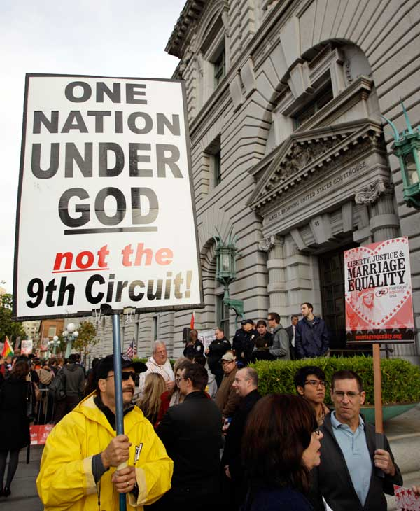 Steve Harris carries a sign against gay marriage outside of the courthouse before a hearing in the Ninth Circuit Court of Appeals, Monday, Dec. 6, 2010, in San Francisco. The federal appeals court in San Francisco plans to hear two hours of arguments Monday about the voter-approved ban known as Proposition 8. A trial court judge overturned the measure as a violation of gay Californians' civil rights in August. (AP Photo/Eric Risberg)