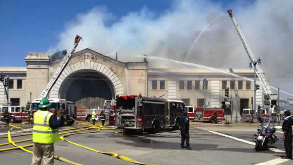 "<div class=""meta image-caption""><div class=""origin-logo origin-image ""><span></span></div><span class=""caption-text"">Fire crews in San Francisco battle a fire at a building under renovation at Pier 29.  Wednesday, June 20, 2012. (Rachel Schwartz/ABC7 News)</span></div>"