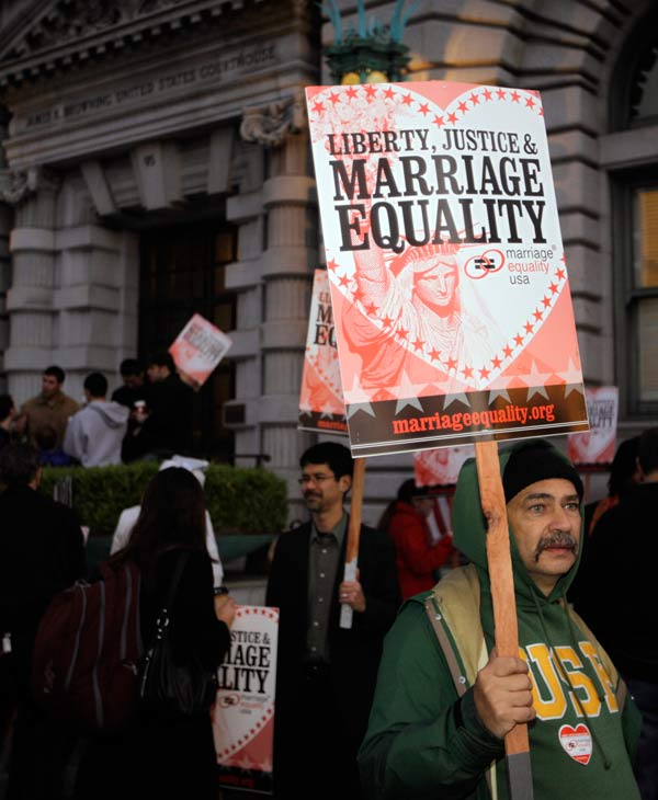 Ernest Camisa, right, of San Francisco, carries a sign in support of gay marriage before a hearing in the Ninth Circuit Court of Appeals, Monday, Dec. 6, 2010, in San Francisco. The federal appeals court in San Francisco plans to hear two hours of arguments Monday about the voter-approved ban known as Proposition 8. A trial court judge overturned the measure as a violation of gay Californians' civil rights in August. (AP Photo/Eric Risberg)