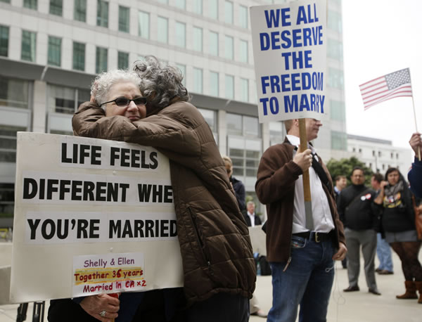 Shelly Bailes, left, hugs her wife Ellen Pontac outside of the Phillip Burton Federal Building in San Francisco, Wednesday, Aug. 4, 2010. A federal judge overturned California's same-sex marriage ban Wednesday in a landmark case that could eventually land before the U.S. Supreme Court to decide if gays have a constitutional right to marry in America, according to a person close to the case. (AP Photo/Eric Risberg)