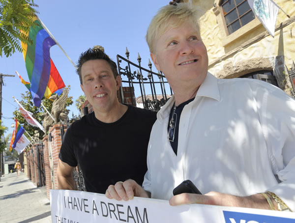 Bill Hacket, left, and his husband Thom Uber stand outside The Abbey, a popular gay bar in West Hollywood, Calif. on Wednesday, Aug. 4, 2010 after a federal judge overturned California's same-sex marriage ban in a landmark case that could eventually land before the U.S. Supreme Court to decide if gays have a constitutional right to marry in America. (AP Photo/Adam Lau)