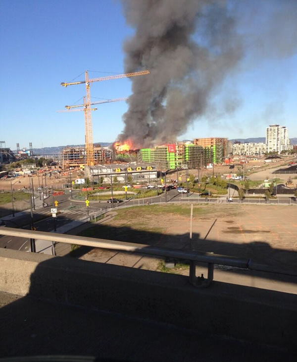 Multi-alarm fire burning at a building under construction at 4th Street near China Basin in San Francisco, CA, March 11, 2014. <span class=meta>(Photo: Courtesy of @Ettalou2267  on Twitter)</span>
