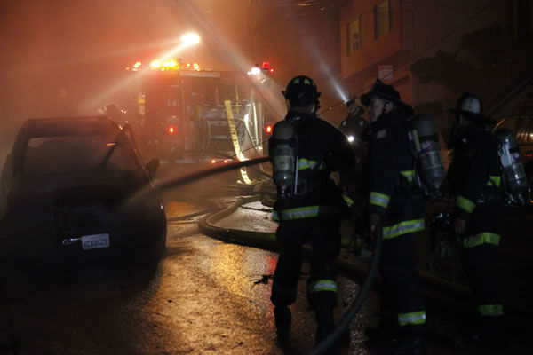 A four-alarm fire burned multiple houses in San Francisco Tuesday morning and left about 10 residents displaced. <span class=meta>(Photo&#47;Photos courtesy of Daniel Gohstand, www.danielphoto.com)</span>