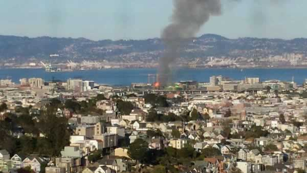 Multi-alarm fire burning at a building under construction at 4th Street near China Basin in San Francisco, CA, March 11, 2014. <span class=meta>(Photo: Courtesy of @marcowhereru on Twitter)</span>