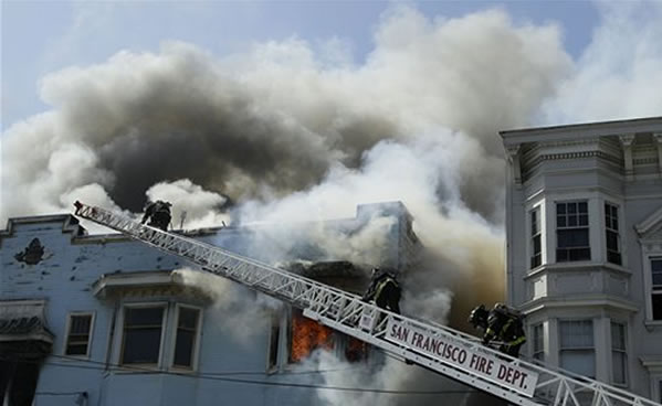 "<div class=""meta image-caption""><div class=""origin-logo origin-image ""><span></span></div><span class=""caption-text"">San Francisco firefighters battle a four-alarm fire at a residential and commercial building on the corner of Valencia Street and Duboce Avenue in San Francisco, Sunday, May 6, 2012. (AP Photo/Jeff Chiu)</span></div>"