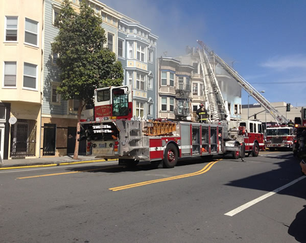 San Francisco firefighters battle a four-alarm...