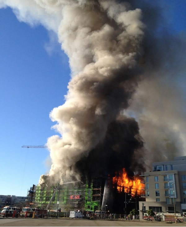 Multi-alarm fire burning at a building under construction at 4th Street near China Basin in San Francisco, CA, March 11, 2014. <span class=meta>(Photo: Courtesy of @nvbound on Twitter)</span>