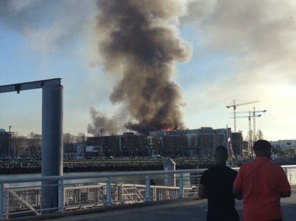 Multi-alarm fire burning at a building under construction at 4th Street near China Basin in San Francisco, March 11, 2014. <span class=meta>(Photo: Courtesy of @tommmizzle on Twitter)</span>