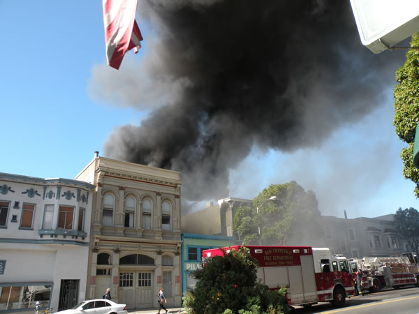 Crews battle a three-alarm fire at 26th and Poplar streets, near San Francisco&#39;s Mission District on October 28, 2013. <span class=meta>(Photo courtesy of Arthur Tong)</span>