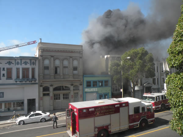"<div class=""meta image-caption""><div class=""origin-logo origin-image ""><span></span></div><span class=""caption-text"">Crews battle a three-alarm fire at 26th and Poplar streets, near San Francisco's Mission District on October 28, 2013. (Photo courtesy of Arthur Tong)</span></div>"